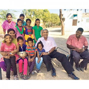 Mr.-Rakesh-Bhatia-with-school-kids-at-their-doorstep